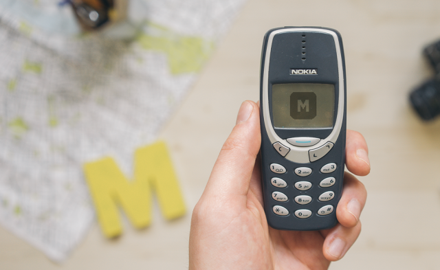 Free mockup of Nokia 3310 held by one hand