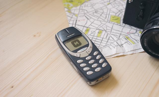 Nokia 3310 on a Wooden Desk Free Mockup
