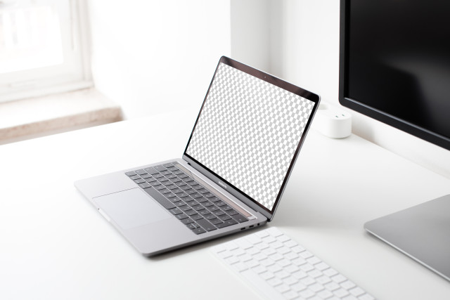 Macbook Pro on the Table Free Mockup